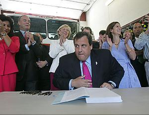 Christie Signing Our Lives Away